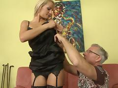 Porn star blonde in stockings gives her lover a great foot-job tube porn video