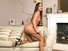 Endearing brunette with small tits in a thong showcasing her nice ass seductively tube porn video