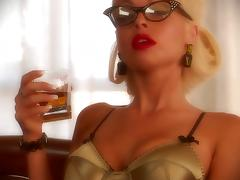 Blonde bombshell Jesse Jane, wearing glasses, plays with a dildo tube porn video