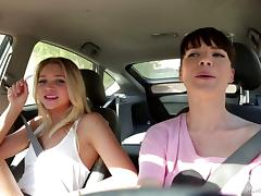 Two daring girls have some hot lesbian sex in the back of a car tube porn video