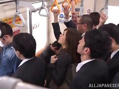 A very daring Japanese babe sucks a guy's cock on a crowded subway tube porn video