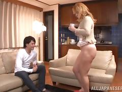 A younger guy feeds his cock to a sexy Japanese MILF tube porn video