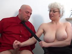 Brutal femdom handjob in office from busty MILF tube porn video