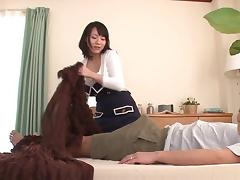 Sitting on a stiff pecker is what this  big tit Asian bombshell loves tube porn video