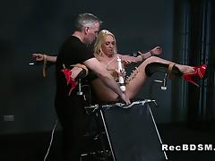 Busty blonde sub strapped in gyno chair squirting tube porn video