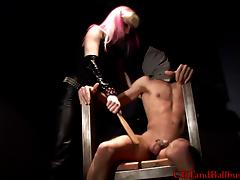 Female captor with pink hair abuses naked prisoner's cock tube porn video