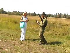 Hot blonde meets a soldier and fucks him in a field tube porn video