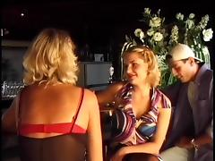 He finds himself a cute blonde in stockings in the club tube porn video