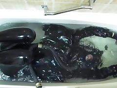 Rubber girl in the bath tube porn video