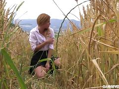 Out in a field of wheat she pulls her panties aside and fingers tube porn video