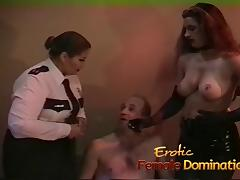 Policewoman and a dominatrix team up to interrogate tube porn video