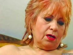 Granny masturbates with a banana tube porn video