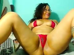 Curvaceous brunette in a tiny red bikini fucks her shaved c tube porn video