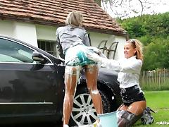 Right on the car's hood,two nasty lesbians enjoy washing and exposing their asses tube porn video