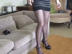 Sexy brunette puts on sheer black stockings on her toned legs tube porn video