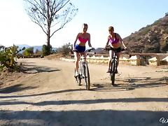 Two bike-riding babes stop to have a nice little lesbian adventure tube porn video