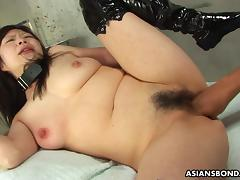 Collared Asian endures rough fingering and a nipple torture tube porn video