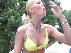 Shaved blonde smokes cigarette and fucks outdoors tube porn video