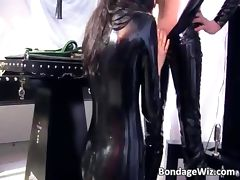 Man in latex dominates over this masked tube porn video