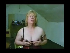 Mature bares her boobs Mature busty woman shows her big breasts lewdly extracting them from her red tube porn video