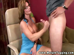 Naughty MILF with glasses jerking cock tube porn video