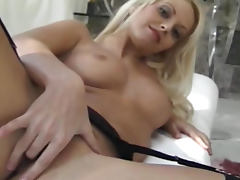 Stockings and a little black dress on a beauty tube porn video
