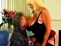 Gigantic tits of a fucked slut in a corset tube porn video
