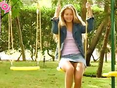 Blonde Girl Peeing While She's On The Swings tube porn video