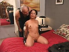 Beautiful young tattooed asian girl is tormented and spanked by Master Len tube porn video