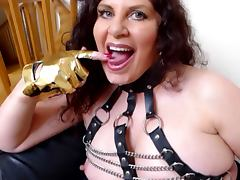 British slut Gilly gives a blowjob to a man in a pig mask tube porn video