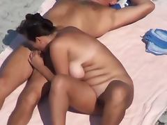 Chubby mature lady pleases her hubby with a blowjob on a beach tube porn video