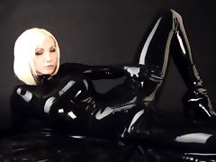 Black latex catsuit and red corset tube porn video