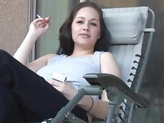 Slender brunette has a cigarette and gives a titjob tube porn video