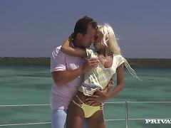 Charming and luscious blondie is riding a huge dick on the yacht tube porn video