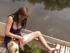 Brunette sits on a boat and fingers her smooth twat tube porn video