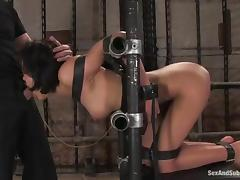 Ruby Knox gets her pussy drilled while being chained in a pillory tube porn video