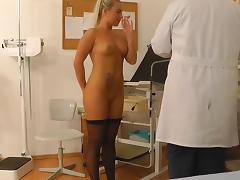 Gyno doctor is fucking this alluring blonde tube porn video